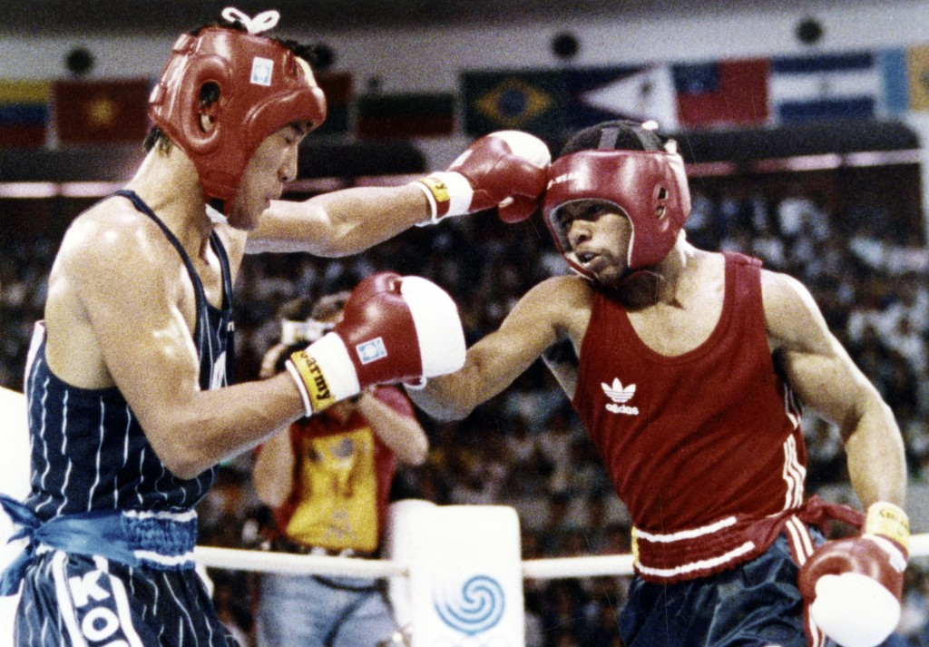 FILE - In this Oct. 2, 1988, file photo, South Korea's Park Si-hun, left, delivers a left jab to America's Roy Jones, and goes on to win the gold meda...