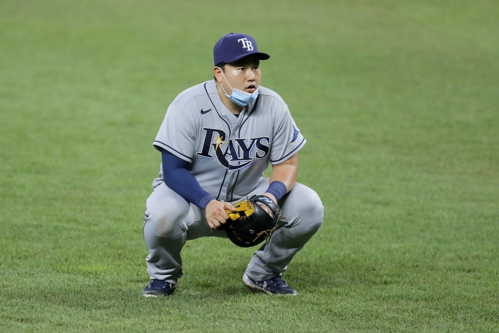 Tampa Bay Rays first baseman Ji-Man Choi reacts after his throw to home plate was too high and catcher Mike Zunino was unable to put out Baltimore Ori...