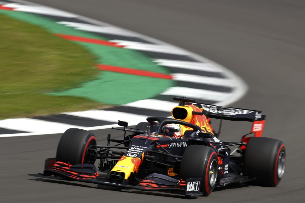 Red Bull driver Max Verstappen of the Netherlands takes a curve during the third free practice session for the British Formula One Grand Prix at the S...