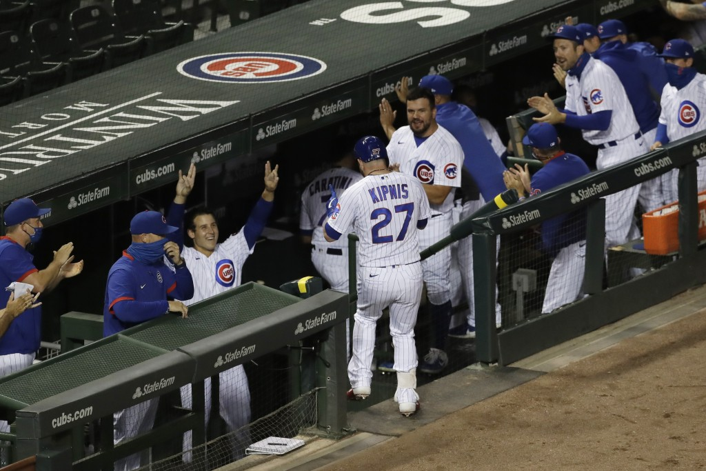 Chicago Cubs' Jason Kipnis (27) is congratulated by teammates after hitting a solo home run against the Pittsburgh Pirates during the fourth inning of...