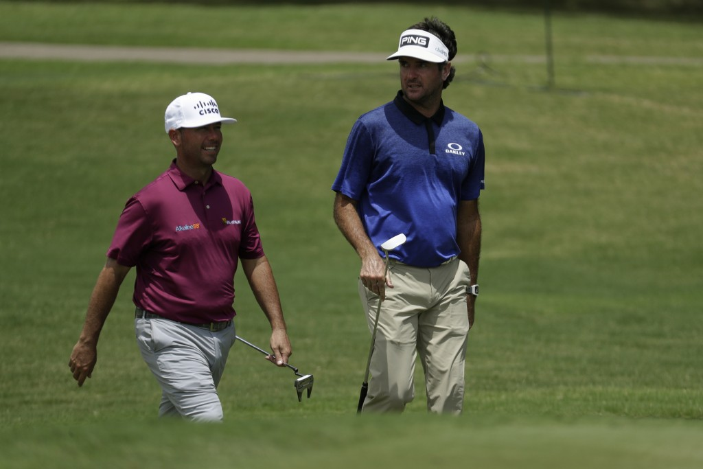 Chez Reavie, left, and Bubba Watson walk to the eighth green during the second round of the World Golf Championship-FedEx St. Jude Invitational Friday...