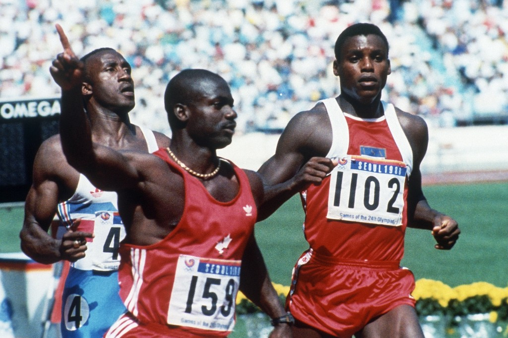 FILE - In this Sept. 25, 1988, file photo, Canadian Ben Johnson, left, signals victory ahead of the United States' Carl Lewis, as he wins the 100-mete...