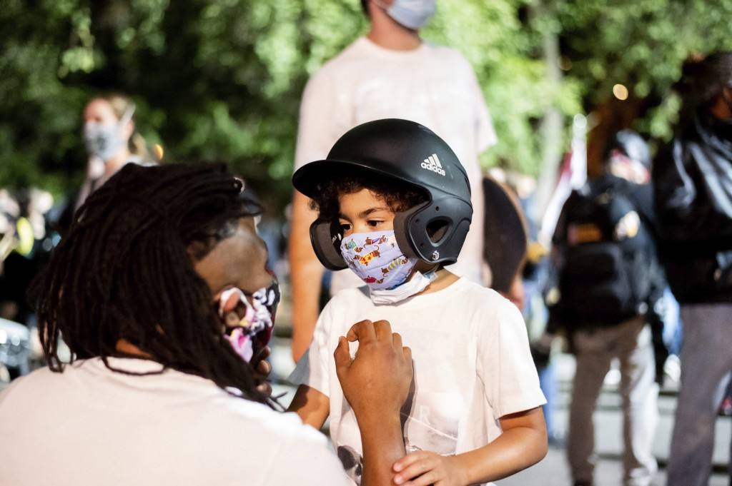 Leshan Terry speaks with his son Leshan Terry, Jr., 6, during a Black Lives Matter protest at the Mark O. Hatfield United States Courthouse on Friday,...