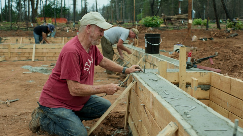 """This image released by National Geographic shows documentary subject Steve """"Woody"""" Culleton rebuilding his home in Paradise, Calif., in a scene from """"..."""