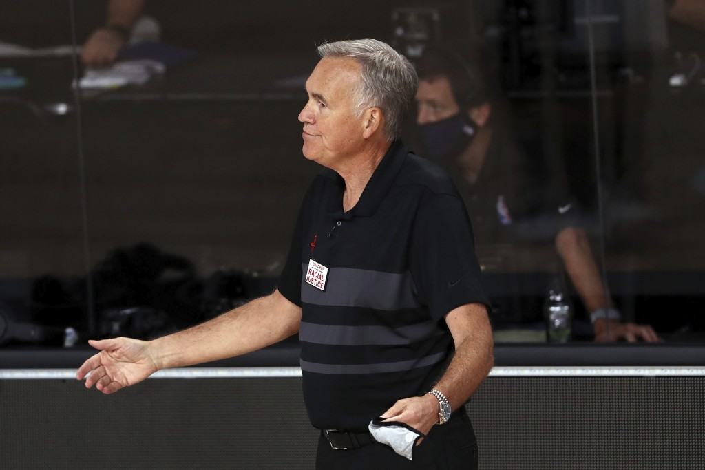 Houston head coach Mike D'Antoni reacts against the Dallas Mavericks during the second half of an NBA basketball game Friday, July 31, 2020, in Lake B...