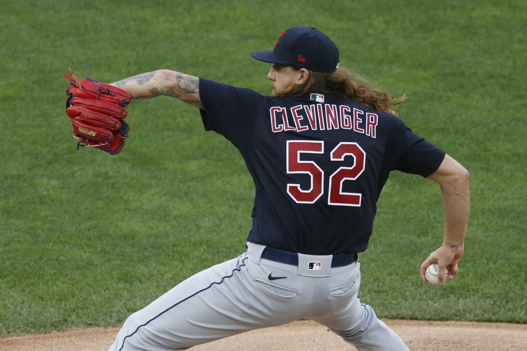 Cleveland Indians pitcher Mike Clevinger throws against the Minnesota Twins in the first inning of a baseball game Friday, July 31, 2020, in Minneapol...