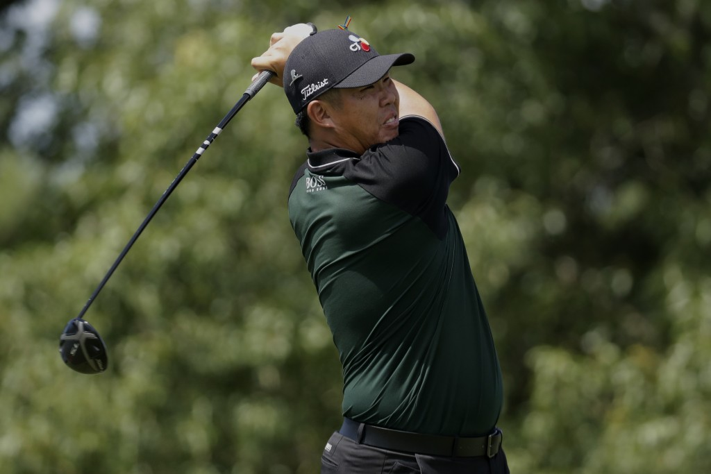 Byeong Hun An of South Korea, watches his tee shot on the ninth hole during the second round of the World Golf Championship-FedEx St. Jude Invitationa...