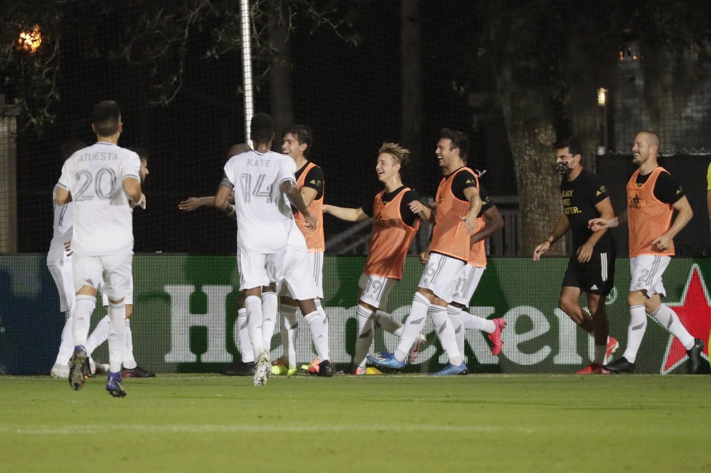 Los Angeles FC players celebrate after a goal during the second half of an MLS soccer match, Friday, July 31, 2020, in Orlando, Fla. (AP Photo/John Ra...