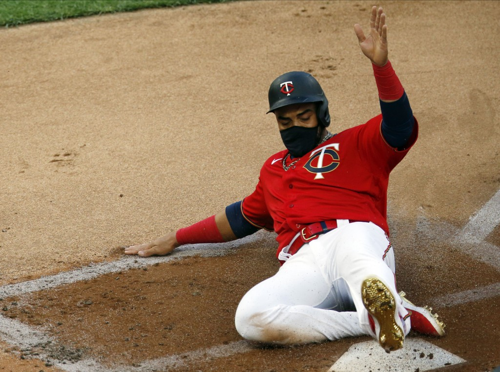 Minnesota Twins' Nelson Cruz scores on a two-run double by Eddie Rosario off Cleveland Indians' pitcher Mike Clevinger in the first inning of a baseba...