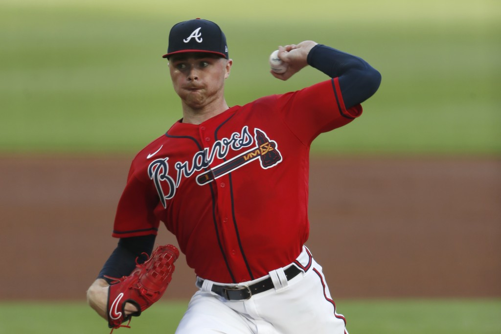 Atlanta Braves relief pitcher Sean Newcomb (15) works in the first inning of a baseball game against the New York Mets Friday, July 31, 2020, in Atlan...