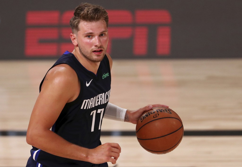 Dallas Mavericks' Luka Doncic dribbles during the second half of an NBA basketball gam against the Houston Rockets, Friday, July 31, 2020, in Lake Bue...