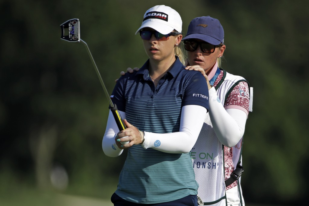 Jodi Ewart Shadoff, left, from England, gets advice from her caddie on her putt on the ninth hole during the first round of the LPGA Drive On Champion...