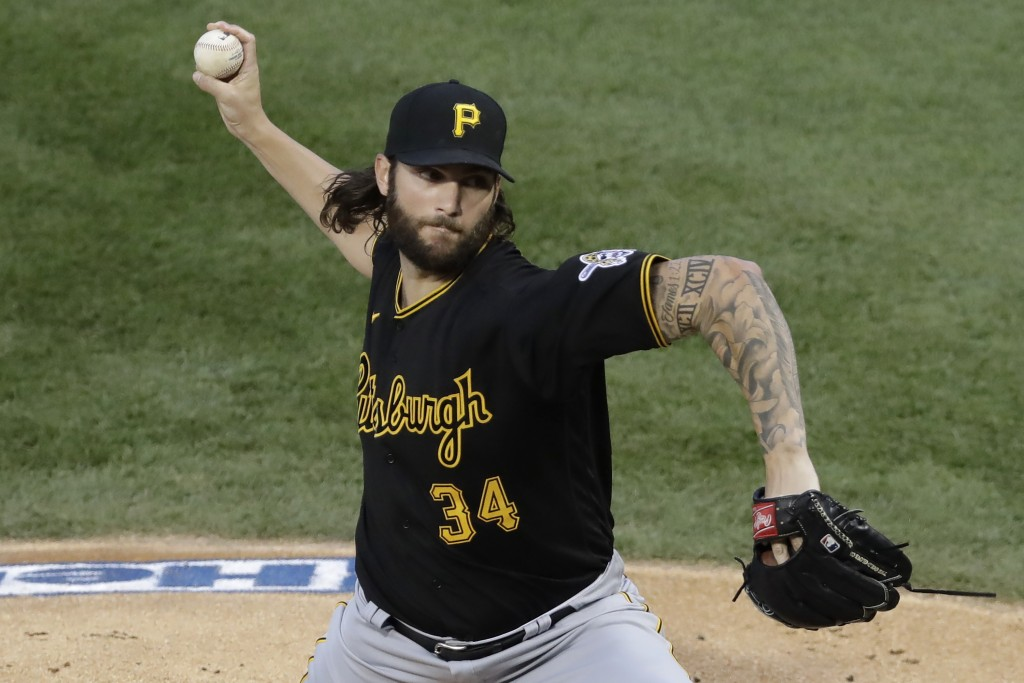 Pittsburgh Pirates starting pitcher Trevor Williams throws against the Chicago Cubs during the first inning of a baseball game in Chicago, Friday, Jul...