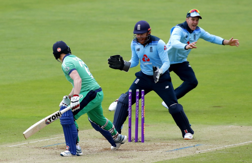 Ireland's Kevin O'Brien, left, is bowled by England's Adil Rashid during the Second One Day Cricket International of the Royal London Series between E...