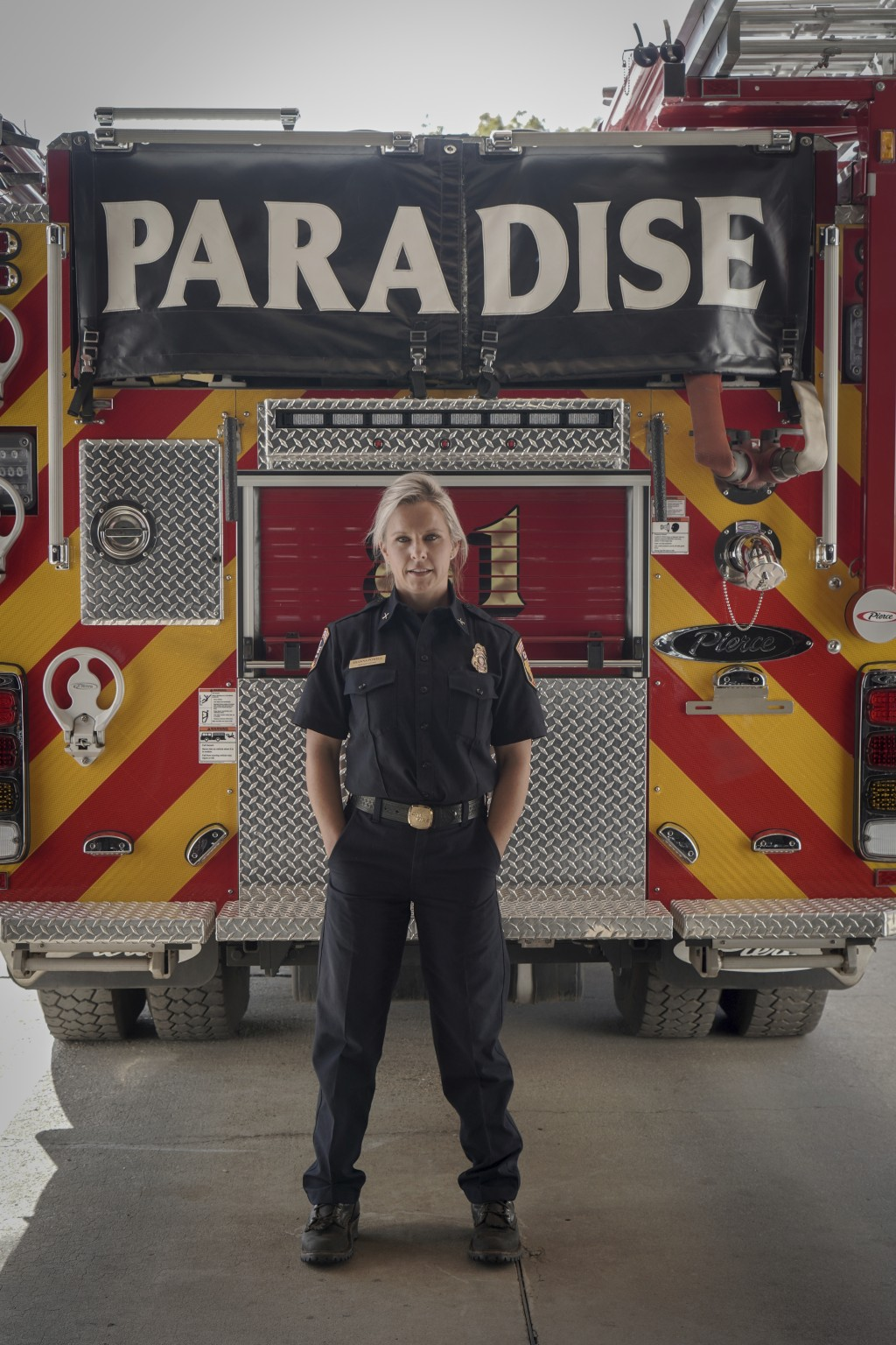 This image released by National Geographic shows firefighter Shawna Powell posing in front of a Paradise Fire Department fire truck in Paradise, Calif...