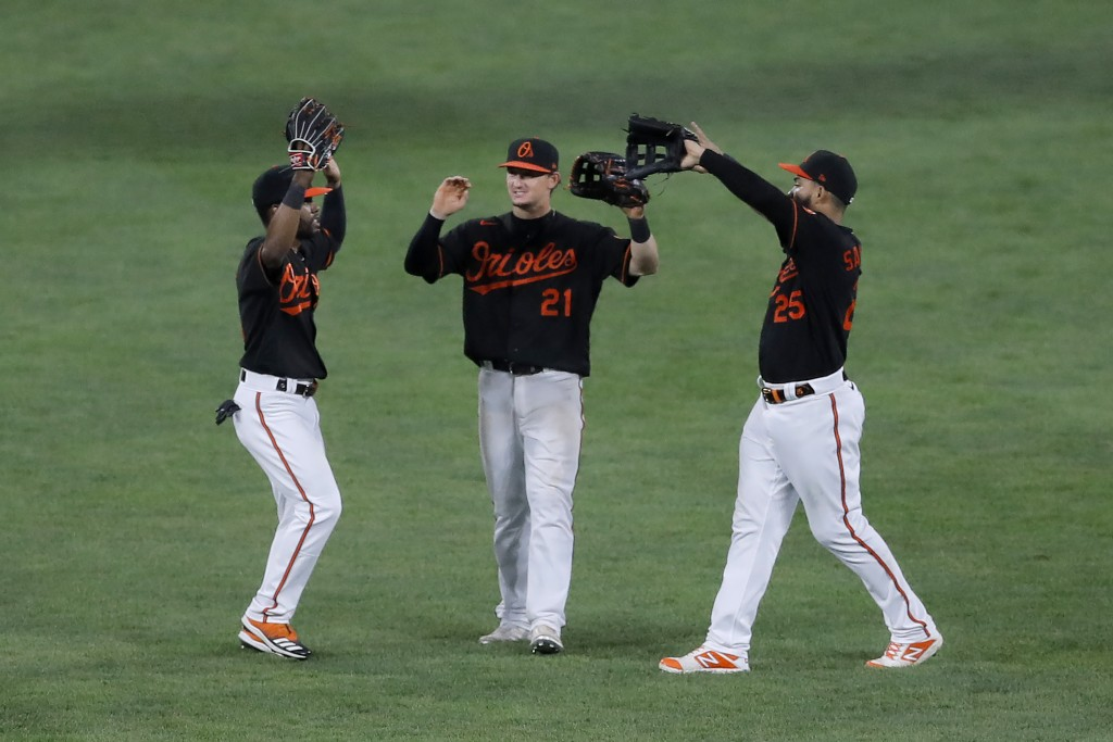 Baltimore Orioles outfielders Cedric Mullins, left, Austin Hays, center, and Anthony Santander celebrate after defeating the Tampa Bay Rays 6-3 during...