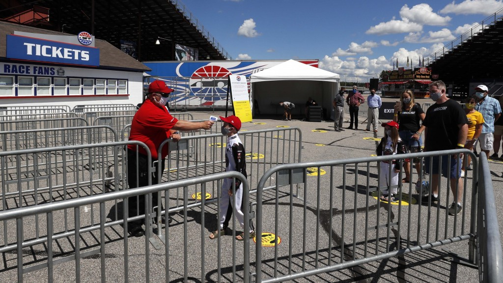 A young fan has his temperature checked during a walkthrough at the New Hampshire Motor Speedway Friday, July 31, 2020, in Loudon, N.H., in preparatio...