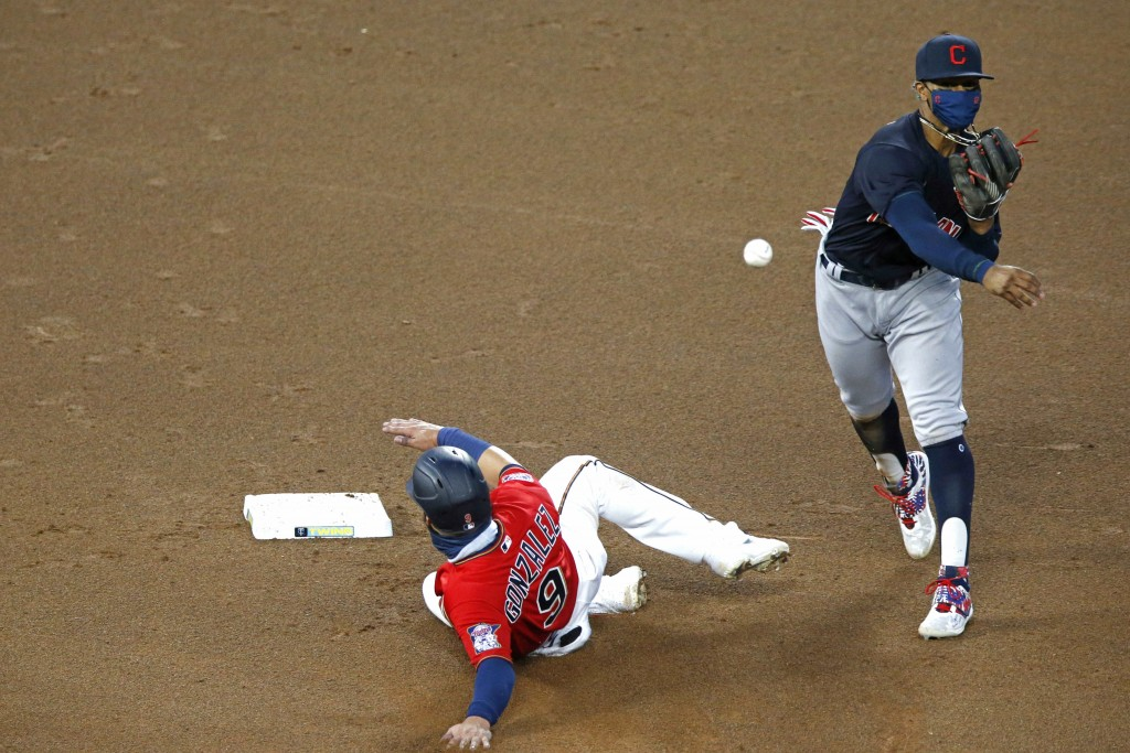 Cleveland Indians shortstop Francisco Lindor, right, throws to first to complete a double play after a force-out at second base of Minnesota Twins' Ma...