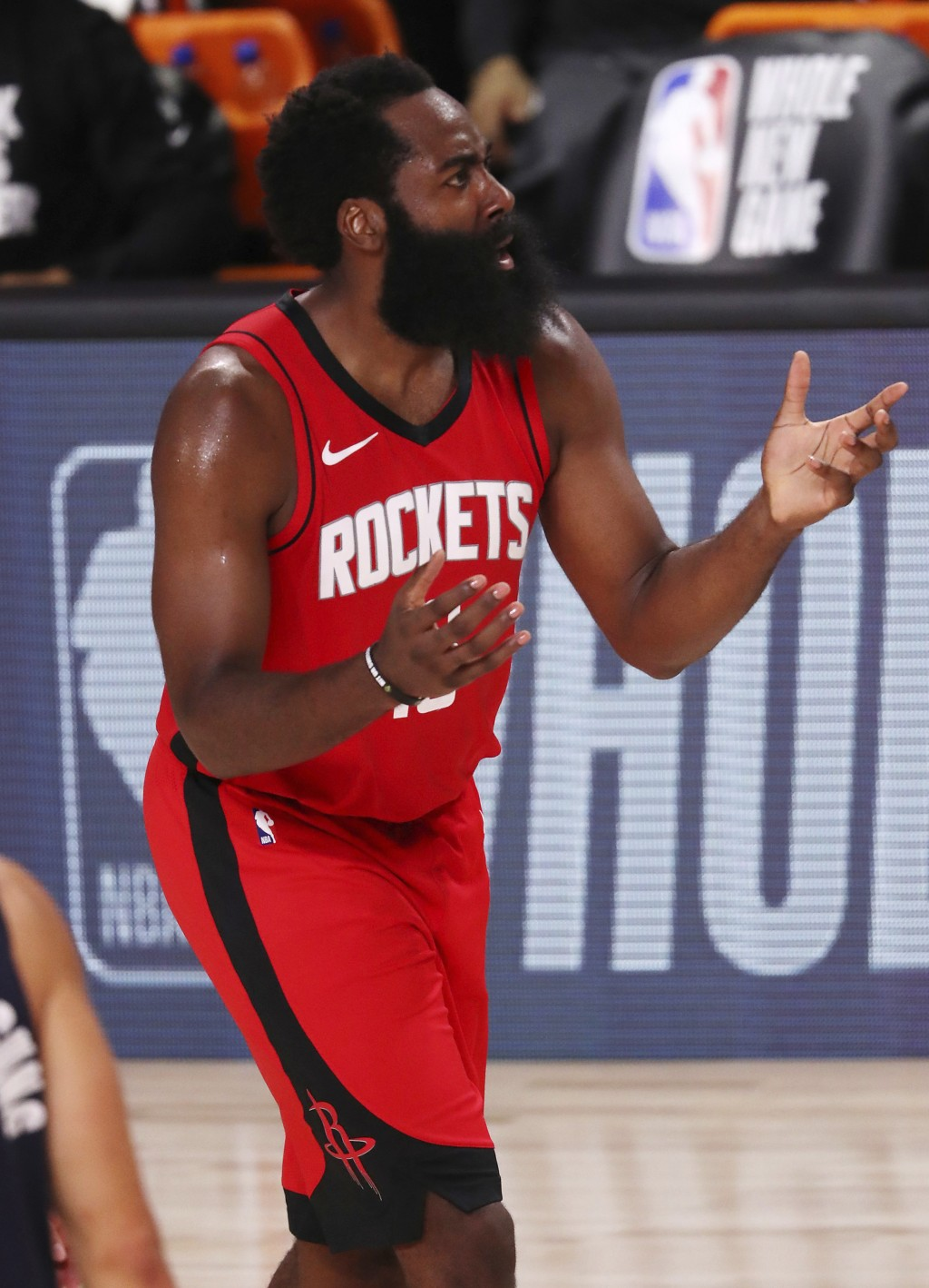 Houston Rockets' James Harden reacts during the second half of an NBA basketball game against the Dallas Mavericks, Friday, July 31, 2020, in Lake Bue...