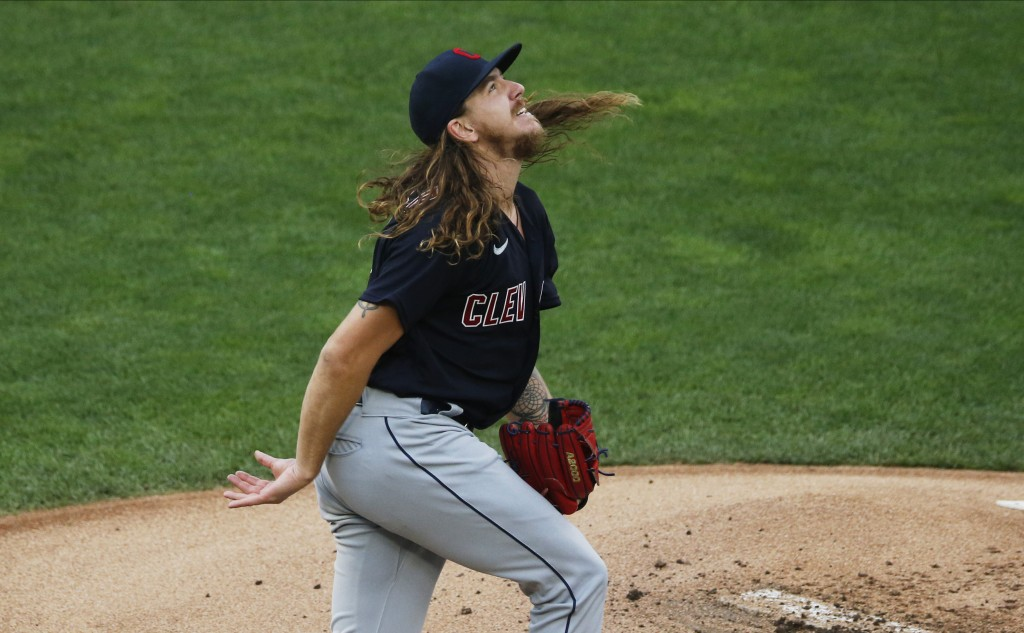Cleveland Indians' pitcher Mike Clevinger watches the flight of a home run ball off the bat of Minnesota Twins' Eddie Rosario in the first inning of a...