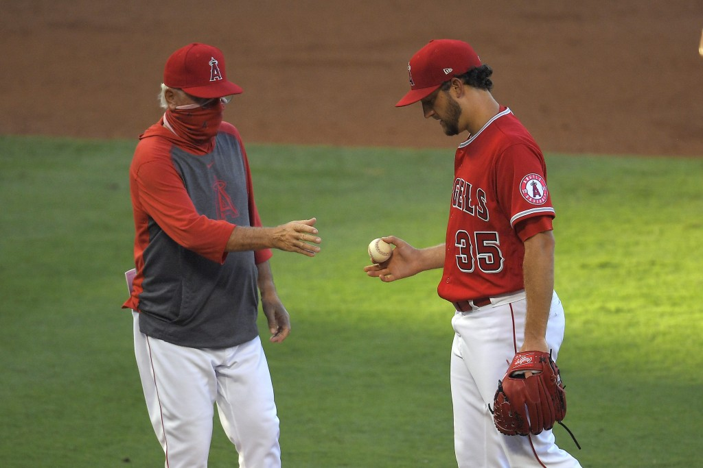 Los Angeles Angels manager Joe Maddon, left, takes starting pitcher Matt Andriese out of the game during the second inning of a baseball game against ...