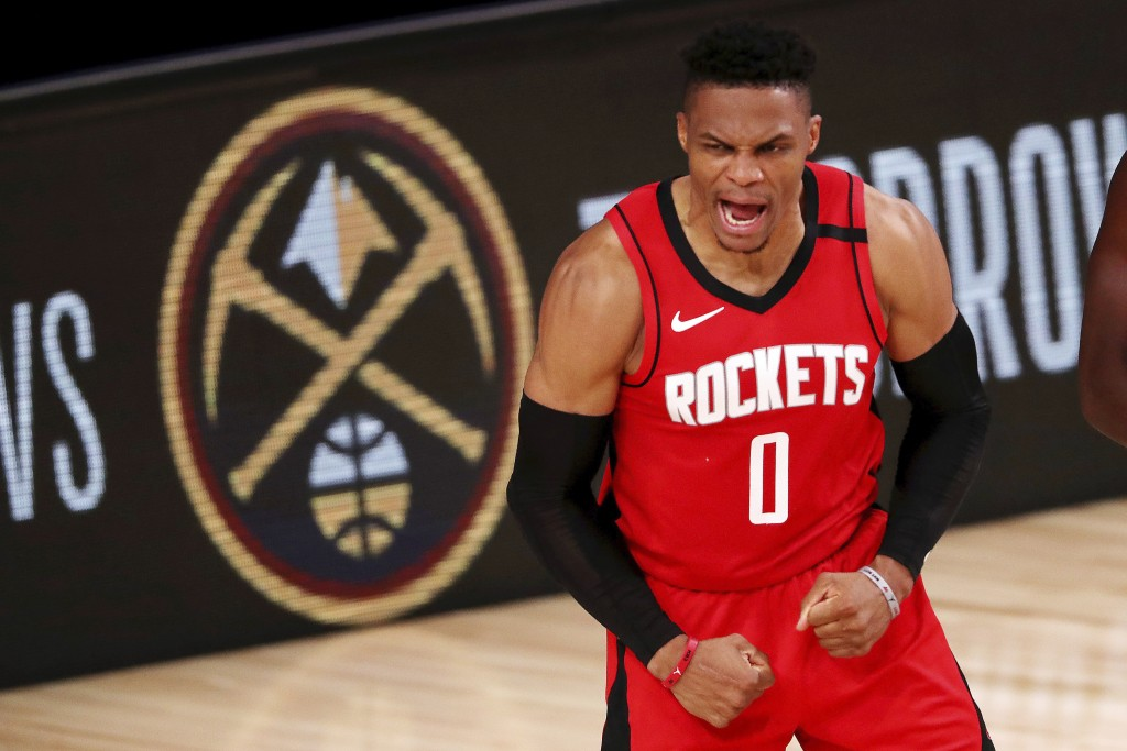 Houston Rockets' Russell Westbrook reacts during the second half of an NBA basketball game against the Dallas Mavericks, Friday, July 31, 2020, in Lak...