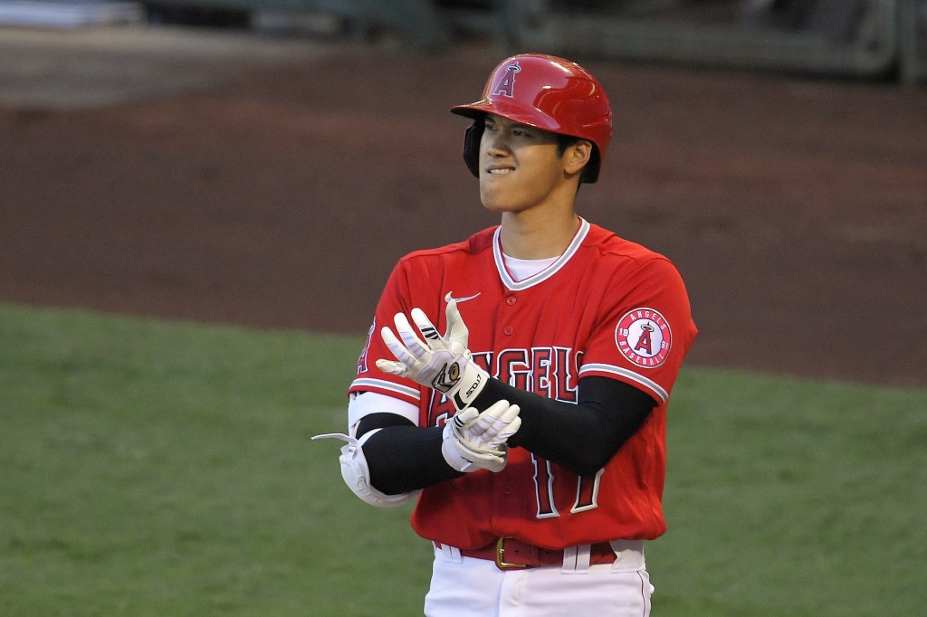 Los Angeles Angels' Shohei Ohtani adjusts his gloves during an at-bat din the first inning of a baseball game against the Houston Astros Friday, July ...