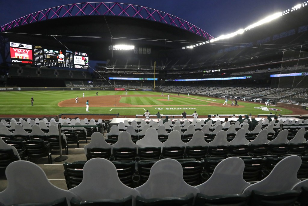 The lower seats of the Seattle Mariners ballpark are partially filled-in with likenesses of fans as the open roof is lit behind as the team plays the ...
