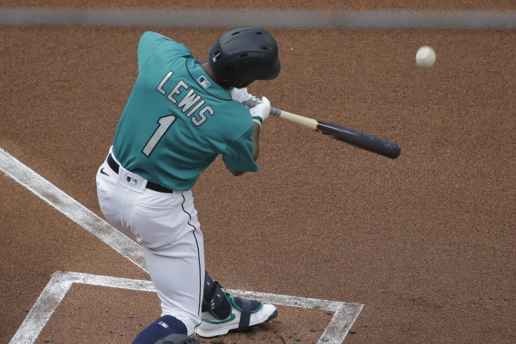 Seattle Mariners' Kyle Lewis pops out during the first inning of a baseball game against the Oakland Athletics, Friday, July 31, 2020, in Seattle. (AP...