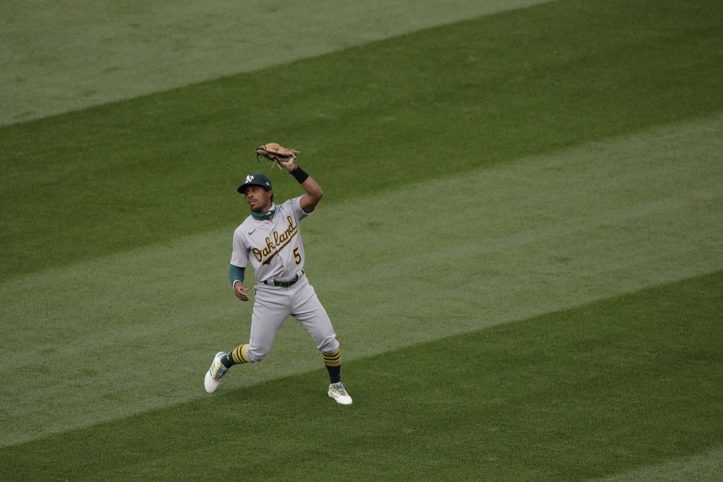 Oakland Athletics second baseman Tony Kemp makes a catch during the first inning of a baseball game against the Seattle Mariners, Friday, July 31, 202...