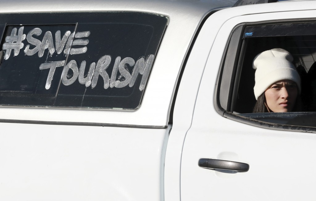 Tour operators take part in a protest in Cape Town, South Africa, Friday July 31, 2020. Various tourism operators staged a slow drive protest as they ...