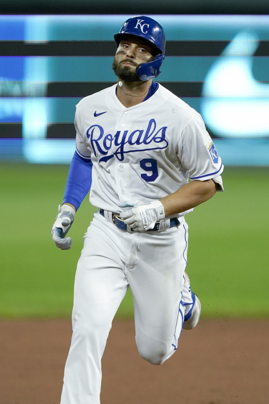 Kansas City Royals' Ryan McBroom rounds the bases after hitting a solo home run during the sixth inning of a baseball game against the Chicago White S...