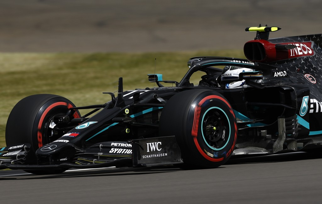 Mercedes driver Valtteri Bottas of Finland steers his car during the third free practice session for the British Formula One Grand Prix at the Silvers...