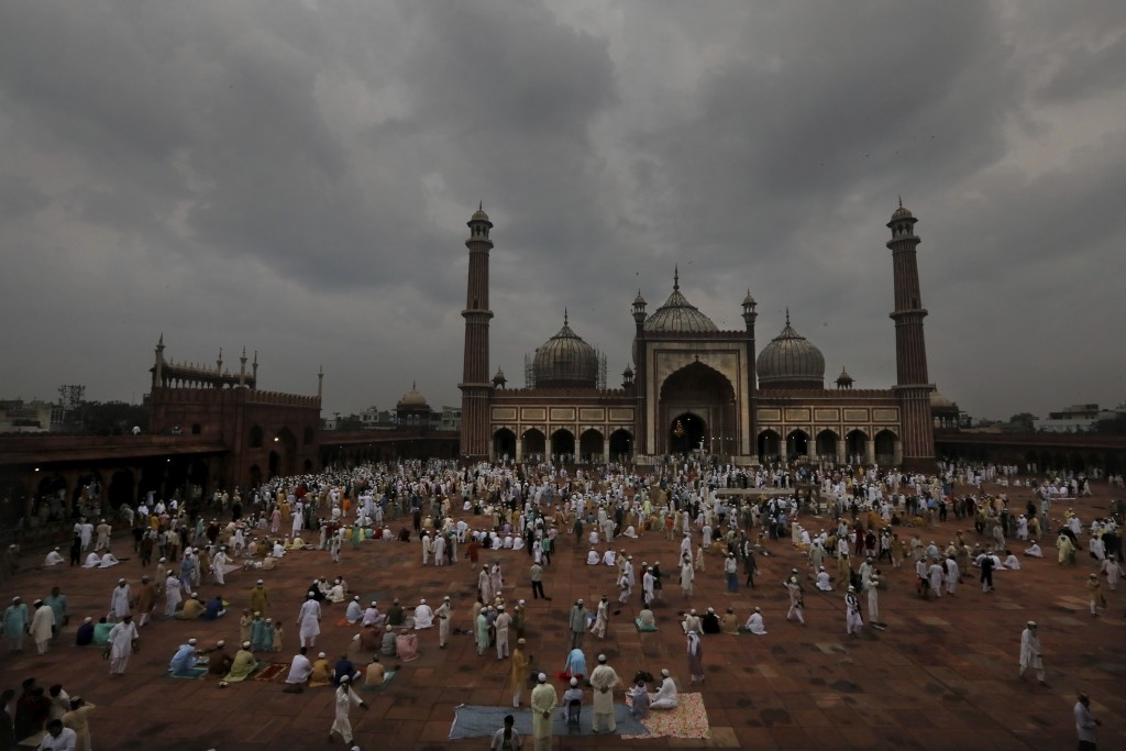 Indian Muslims wait as others leave after offering Eid al-Adha prayer at the Jama Masjid in New Delhi, India, Saturday, Aug.1, 2020. Eid al-Adha, or t...