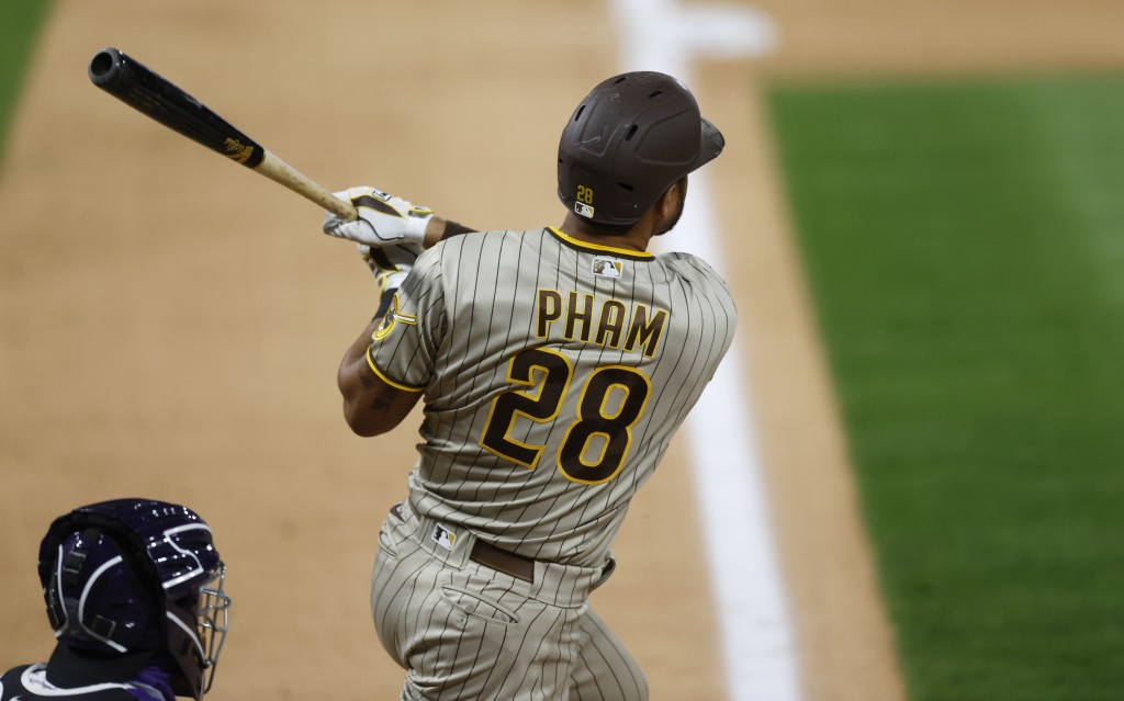 San Diego Padres' Tommy Pham follows the flight of his three-run home run off Colorado Rockies relief pitcher Wade Davis in the ninth inning of a base...