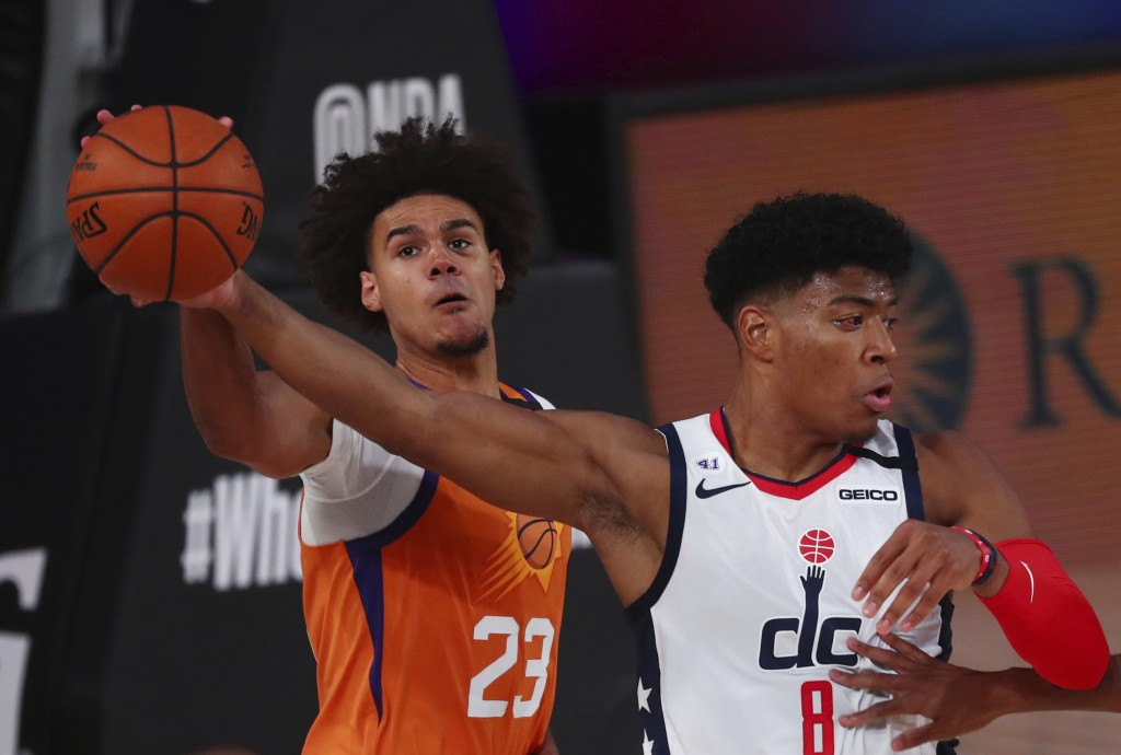 Washington Wizards forward Rui Hachimura (8) battles for the ball with Phoenix Suns forward Cameron Johnson (23)  during the second half of an NBA bas...