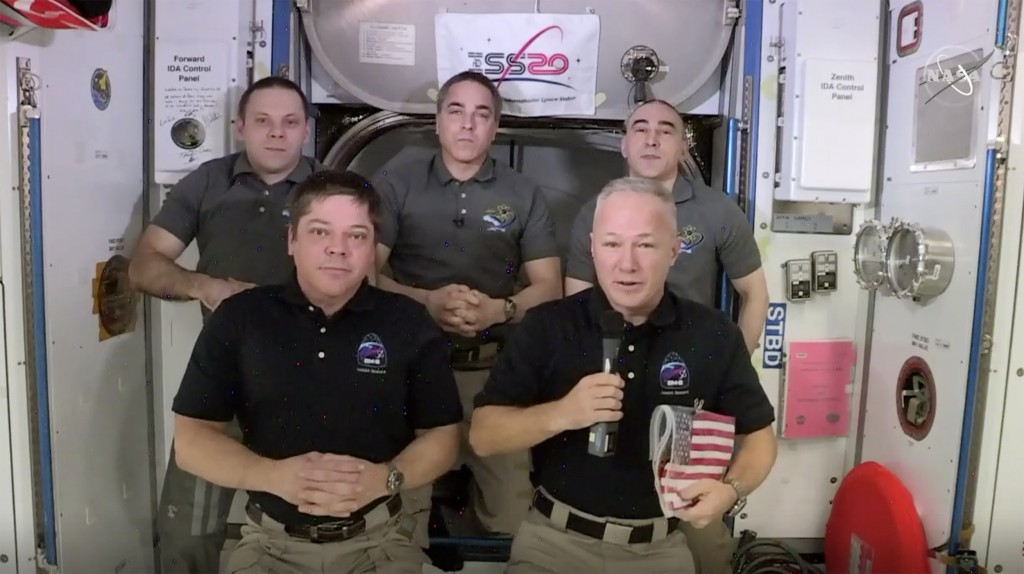 This photo provided by NASA shows, from left, front, astronauts Bob Behnken and Doug Hurley during an interview on the International Space Station on ...