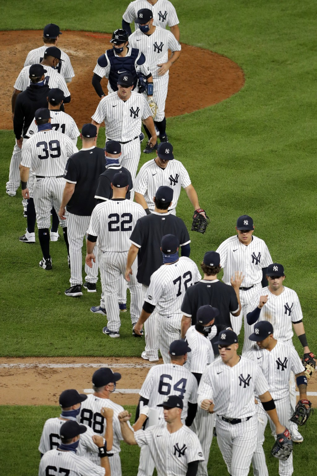 The New York Yankees celebrate after the baseball game against the Boston Red Sox at Yankee Stadium, Friday, July 31, 2020, in New York. The Yankees d...