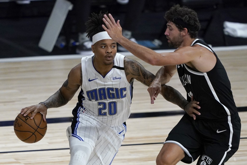 Orlando Magic's Markelle Fultz (20) heads to the basket as Brooklyn Nets' Joe Harris, right, defends during the first half of an NBA basketball game F...