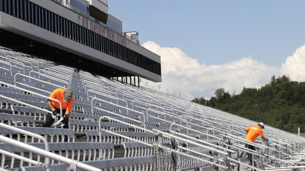 Cleaners, who will be working during the race, clean handrails during a walkthrough at the New Hampshire Motor Speedway, Friday, July 31, 2020, in Lou...