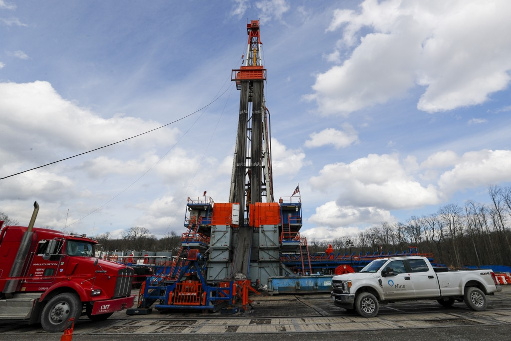 FILE - In this file photo from March 12, 2020, work continues at a shale gas well drilling site in St. Mary's, Pa. (AP Photo/Keith Srakocic, File)