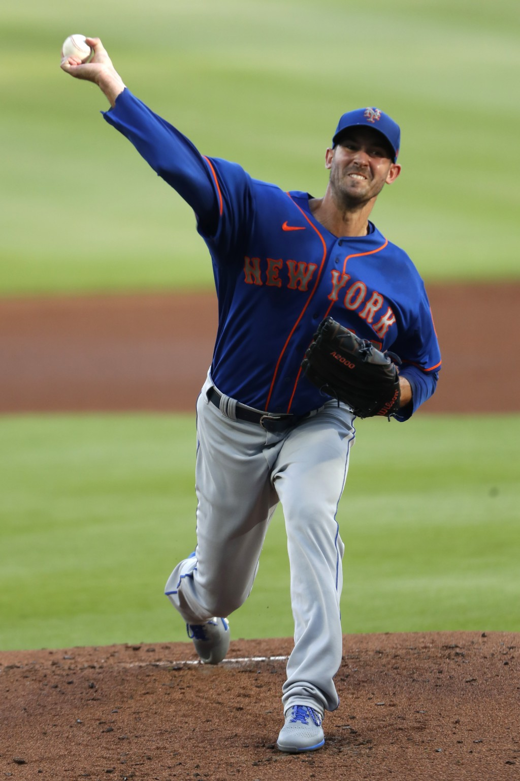New York Mets starting pitcher Rick Porcello delivers in the first inning of a baseball game against the Atlanta Braves, Friday, July 31, 2020, in Atl...