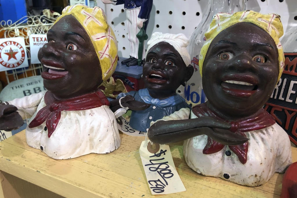 """Cookie jars and other figurines modeled after a """"Mammy"""" image are for sale at the Exit 76 Antique Mall in Edinburgh, Indiana, Tuesday, July 21, 2020. ..."""