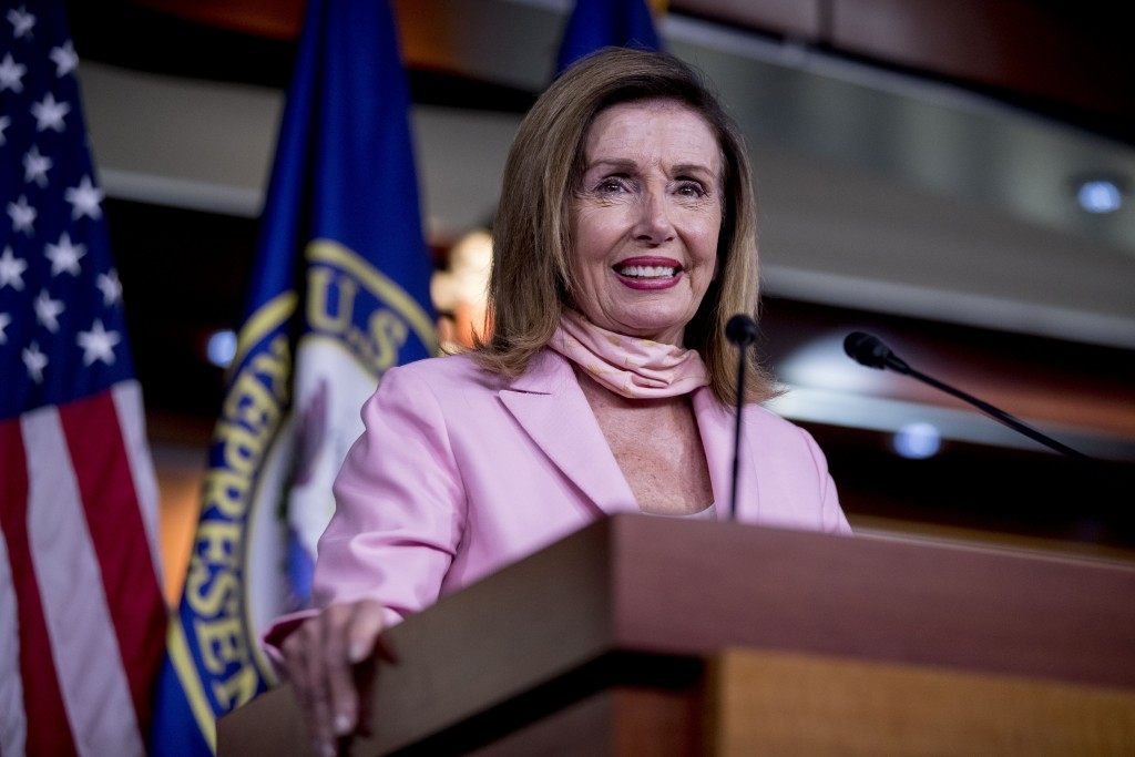 House Speaker Nancy Pelosi of Calif. smiles while speaking at a news conference on Capitol Hill in Washington, Friday, July 31, 2020. (AP Photo/Andrew...