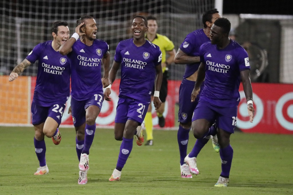 Orlando City forward Nani (17) celebrates after scoring the winning goal with teammates Kyle Smith (24), Andres Perea (21), Antonio Carlos (25) and Da...