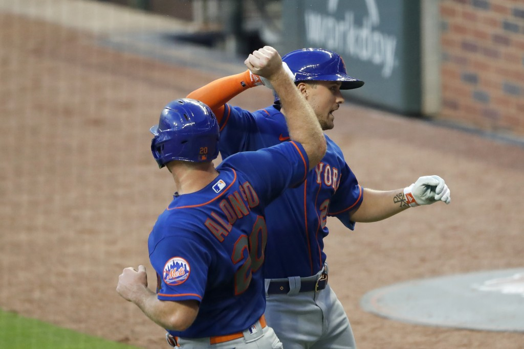 New York Mets' J.D. Davis (28) celebrates with Pete Alonso (20) after hitting a two-run home run in the fourth inning of a baseball game Atlanta Brave...