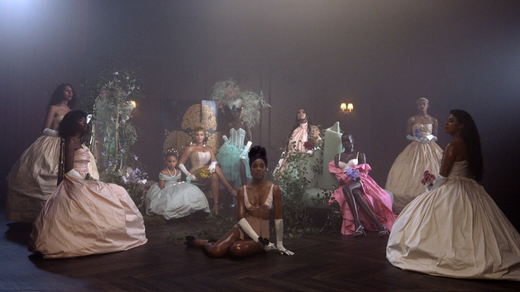 """This image released by Disney Plus shows Beyoncé and her daughter Blue Ivy Carter, seated background left, and Kelly Rowland, center, in """"Brown Skin G..."""