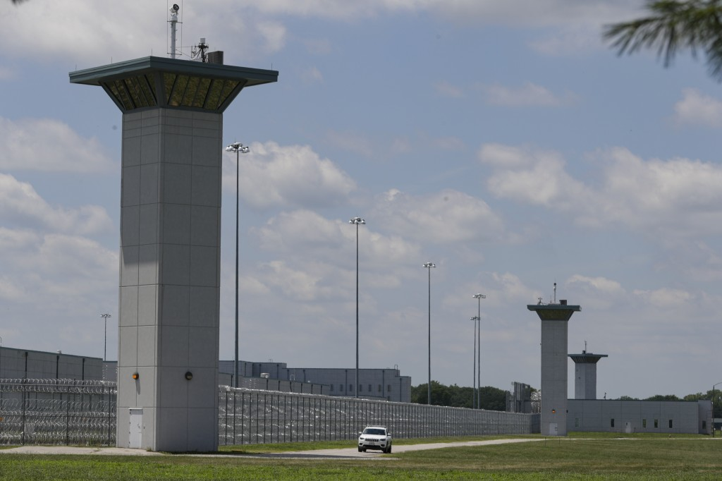 FILE - In this July 17, 2020, file photo the federal prison complex in Terre Haute, Ind., is shown. The Justice Department scheduled two additional fe...