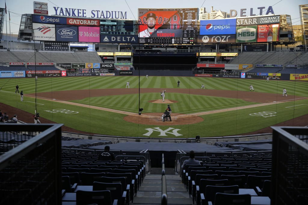 The stadium is almost totally empty during the second inning of a baseball game between the New York Yankees and the Boston Red Sox at Yankee Stadium,...