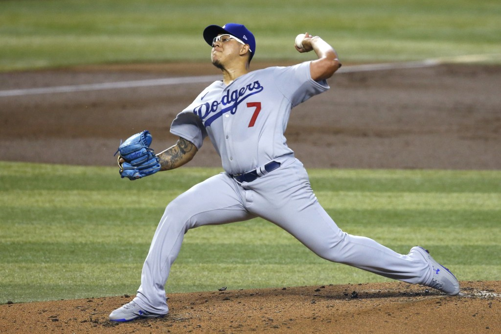 Los Angeles Dodgers starting pitcher Julio Urias throws to an Arizona Diamondbacks batter during the first inning of a baseball game Saturday, Aug. 1,...
